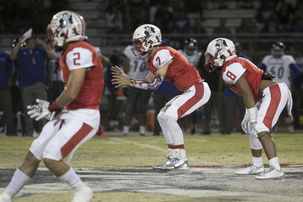 Liberty's quarterback Kenyon Oblad (7) hikes the ball against Desert Pines during a varsity football game at Liberty High School in Henderson on Thursday, Sept. 15, 2016. Richard Brian/Las  ...
