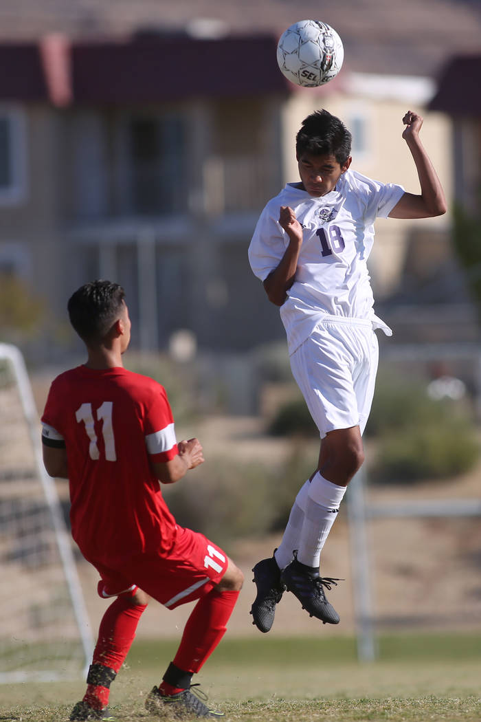 Sunrise Mountain player Johnny Pedraza (18) heads the ball during a game against Western at Sunrise Mountain High School in Las Vegas, Wednesday, Sept. 27, 2017. Sunrise Mountain won 3-0. Bridget  ...