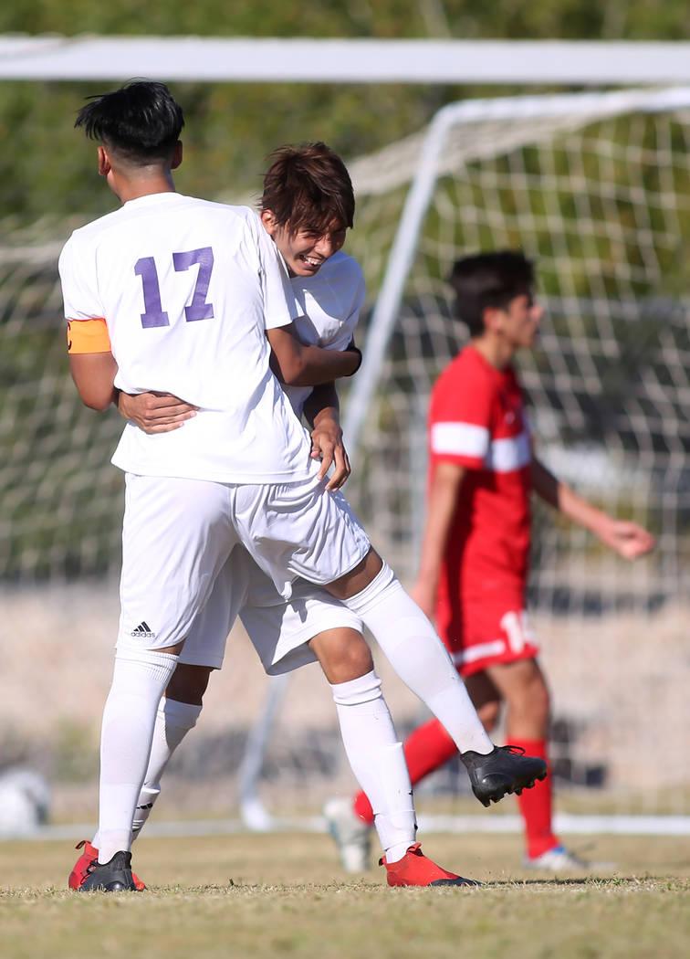 Sunrise Mountain player Bryan Garcia (17) congratulates teammate Felipe Lucero (11) on a goal during a game against Western at Sunrise Mountain High School in Las Vegas, Wednesday, Sept. 27, 2017. ...