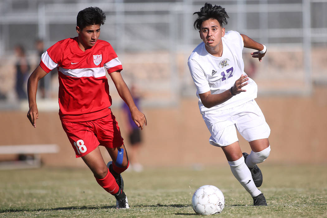 Western player Hector Riquelme (18) chases after Sunrise Mountain player Bryan Garcia (17) with the ball during a game at Sunrise Mountain High School in Las Vegas, Wednesday, Sept. 27, 2017. Sunr ...