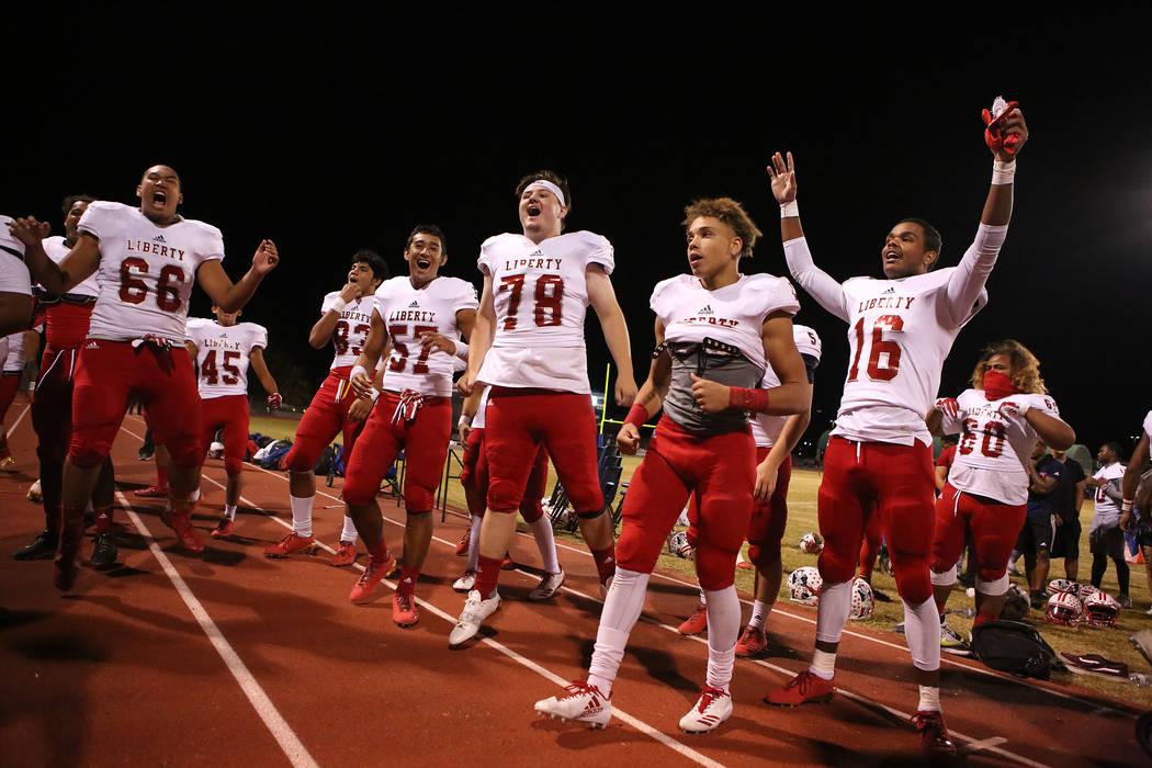 Liberty player celebrate after their 49-14 win over Green Valley at Green Valley High School in Henderson, Thursday, Sept. 28, 2017. Bridget Bennett Las Vegas Review-Journal @BridgetKBennett