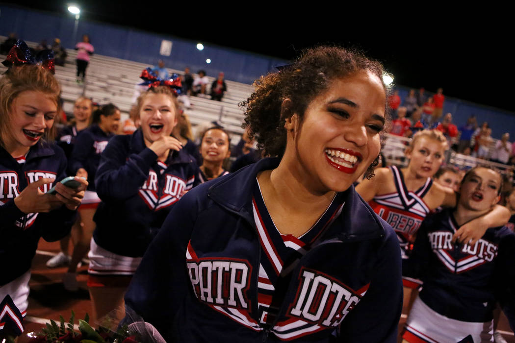 Liberty cheerleader Ciana Miller smiles as she is asked to homecoming by Liberty football player Austin Fiaseu (8) after Liberty's 49-14 win over Green Valley at Green Valley High School in Hender ...