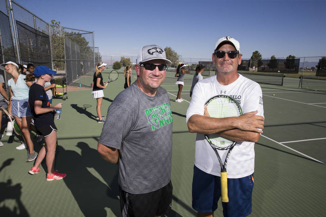 Palo Verde's tennis head coach Richard Coop, left, and girl's assistant coach Scoty Graber during a team practice at Palo Verde High School in Las Vegas, Wednesday, Sept. 27, 2017. Erik Verduzco L ...
