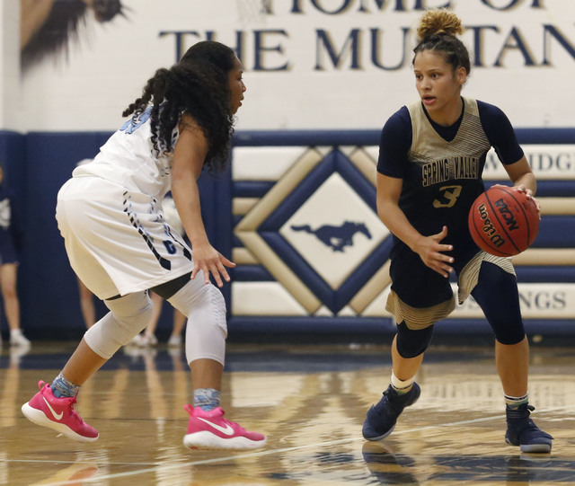 Spring Valley's Essence Booker (3) drives down the court during the first half of a Class 4A Sunset Region championship girls basketball game on Saturday, Feb. 18, 2017, in North Las Vegas. (Chris ...