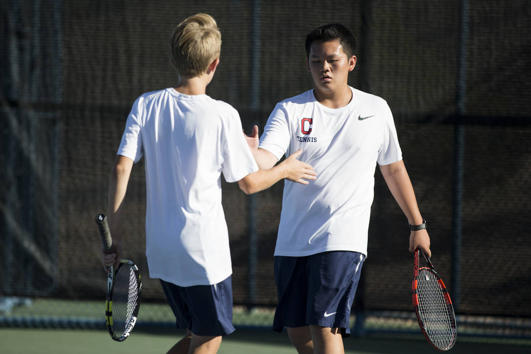 Coronado's Jonah Blake, left, and Thomas Nguyen during their doubles match at the Darling Tennis Center in Las Vegas, Thursday, Oct. 5, 2017. Erik Verduzco/Las Vegas Review-Journal