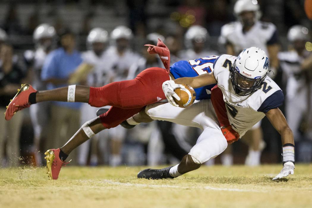 Liberty's Zyrus Fiaseu (22) tackles Foothill's Jordan Blakely (2) in their football game at Liberty High School in Henderson, Friday, Oct. 6, 2017. Liberty won 43-9. Erik Verduzco Las Vegas Review ...