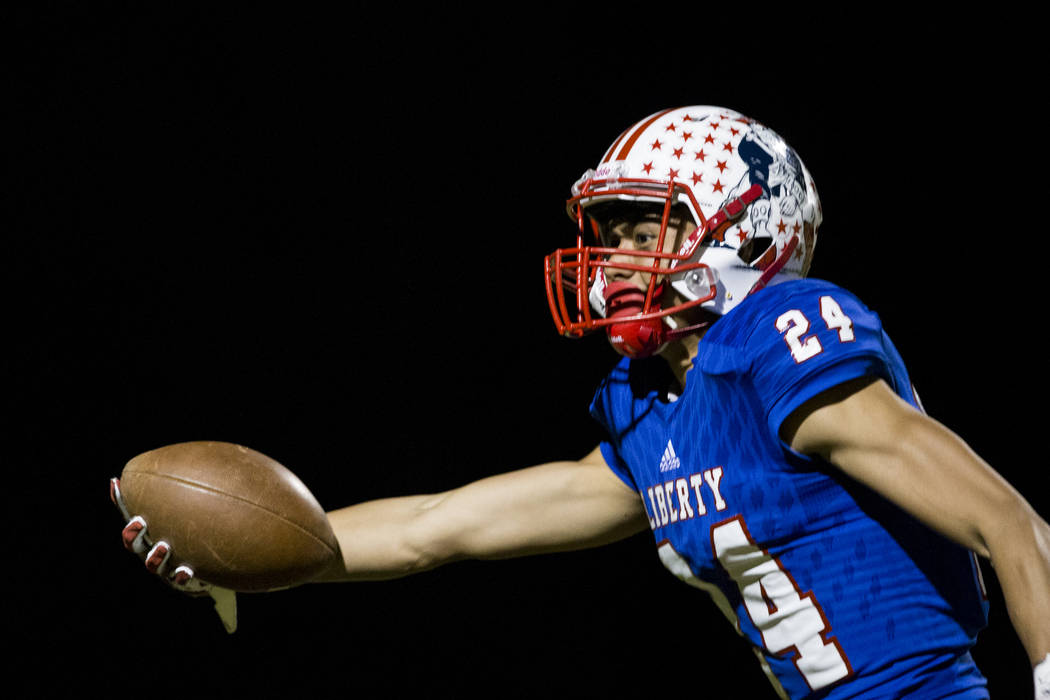 Liberty's Lehi Ausage (24) runs the ball after a catch for a touchdown against Foothill in their football game at Liberty High School in Henderson, Friday, Oct. 6, 2017. Erik Verduzco Las Vegas Re ...