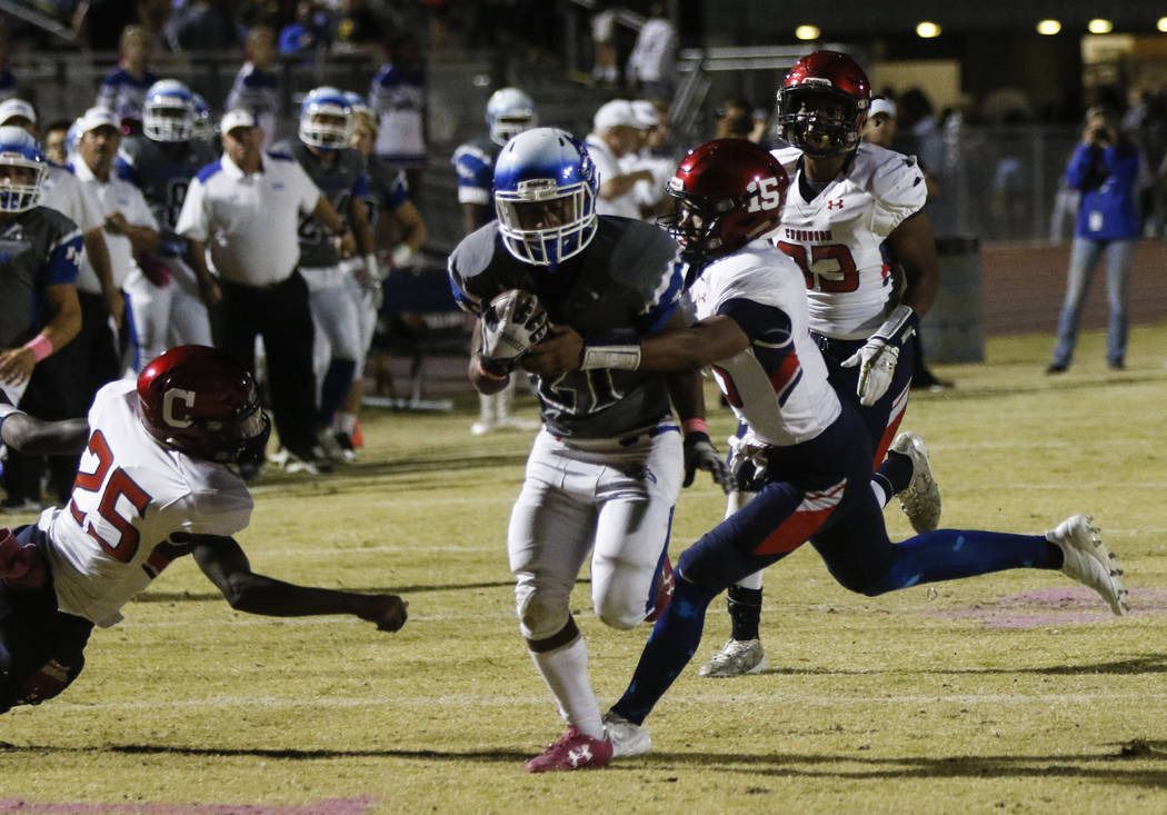 Coronado's Ayzayah Hartfield (15) tackles Basic's Dorian McAllister (21) during a football game at Basic High School in Henderson on Friday, Oct. 6, 2017. Chase Stevens Las Vegas Review-Journal @c ...