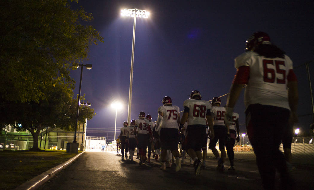 Coronado players head to the field before a football game at Basic High School in Henderson on Friday, Oct. 6, 2017. Hartfield died while off-duty in Sunday's mass shooting. Chase Stevens Las Vega ...