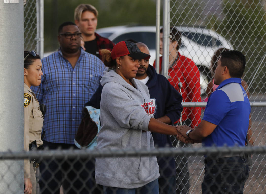 Victoria Hartfield, wife of fallen Las Vegas police officer Charleston Hartfield, arrives with relatives before a football game at Basic High School in Henderson on Friday, Oct. 6, 2017. Hartfield ...