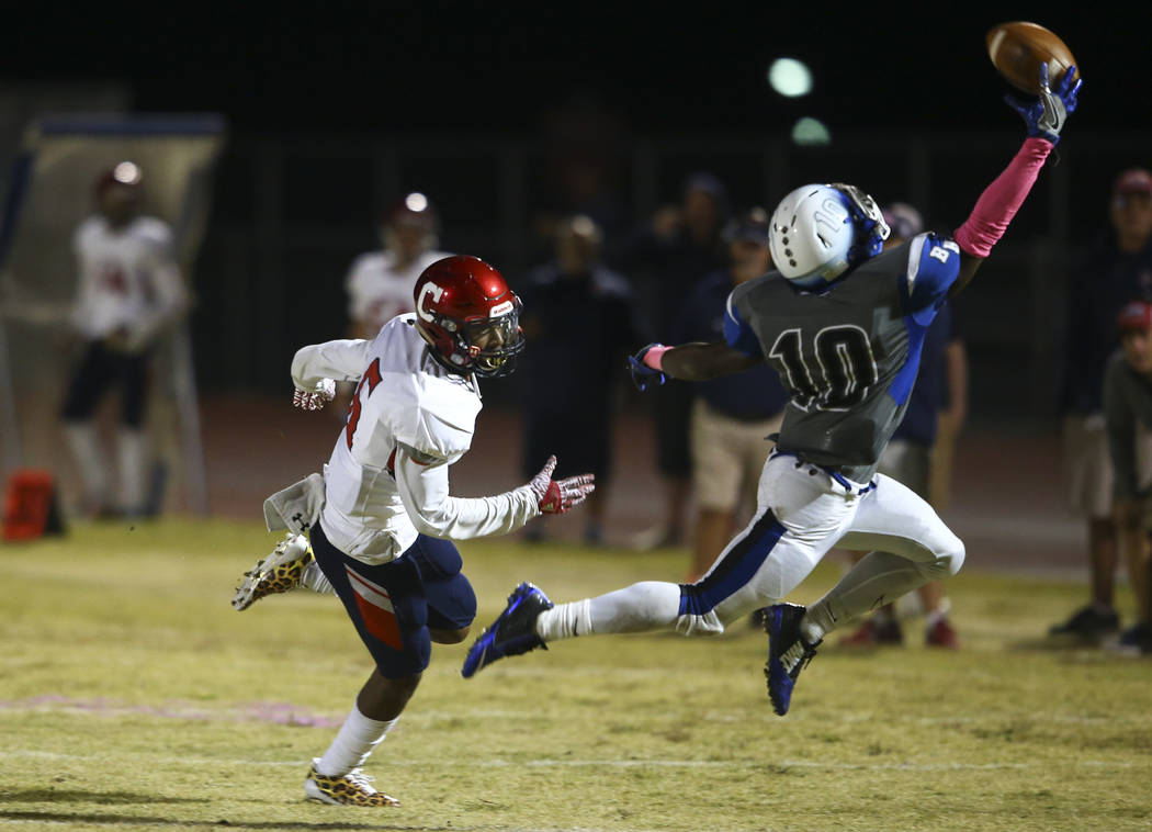 Basic's Franco Mays (10) tries to intercept a pass intended for Coronado's Semaj Bolin (6) during a football game at Basic High School in Henderson on Friday, Oct. 6, 2017. Basic won 45-22. Chase  ...