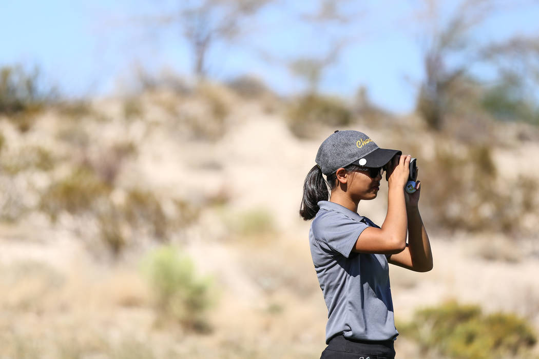 Clark's Riana Mission scouts the golf course during the Class 4A Sunrise and Sunset Region girls golf tournaments at Bearճ Best Golf Club in Las Vegas, Tuesday, Oct. 10, 2017. Joel Angel Jua ...