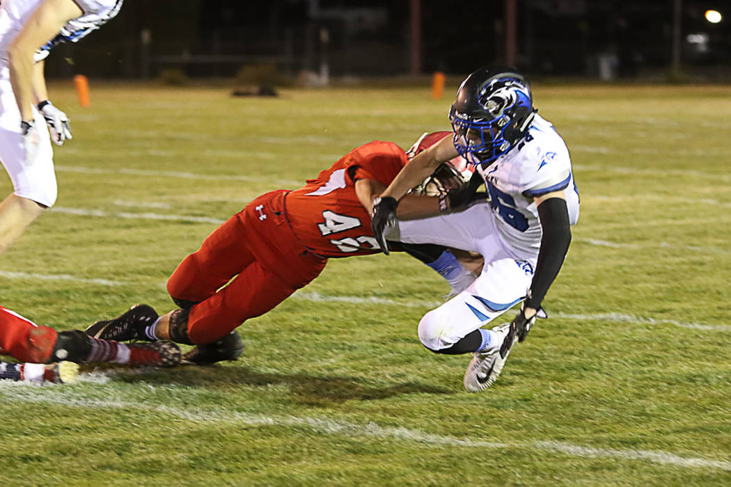 Vance Day  tackles an Alamo players during the game on Friday against the Panthers. Pahranagat Valley's offensive machine was too much for the Muckers Defense as they scored 70 points. (Carl Paice ...