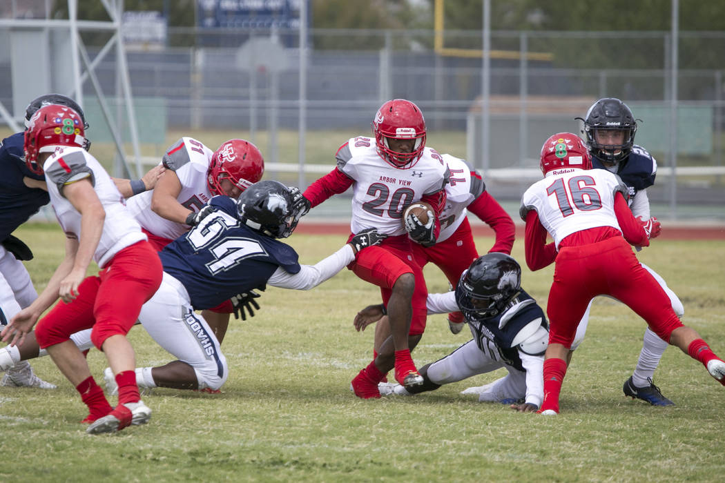 Arbor View's Jaquari Hannie (20) breaks through Shadow Ridge defense during a football game at Shadow Ridge High School on Saturday, Sept. 23, 2017, in Las Vegas. Richard Brian Las Vegas Review-Jo ...
