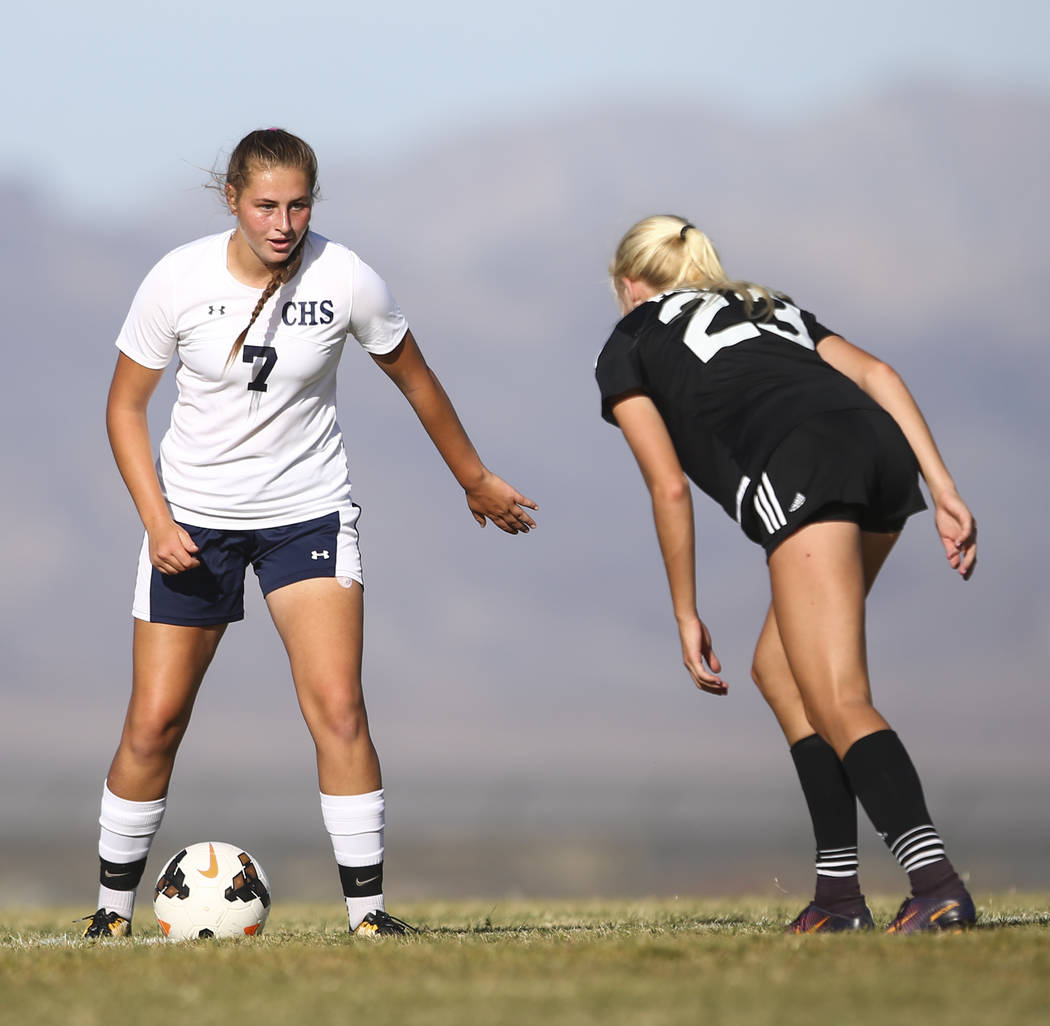 Centennial's Marcella Brooks (7) looks to get past Palo Verde's Kate Fann (23) during a soccer game at Centennial High School in Las Vegas on Tuesday, Sept. 19, 2017. Chase Stevens Las Vegas Revie ...