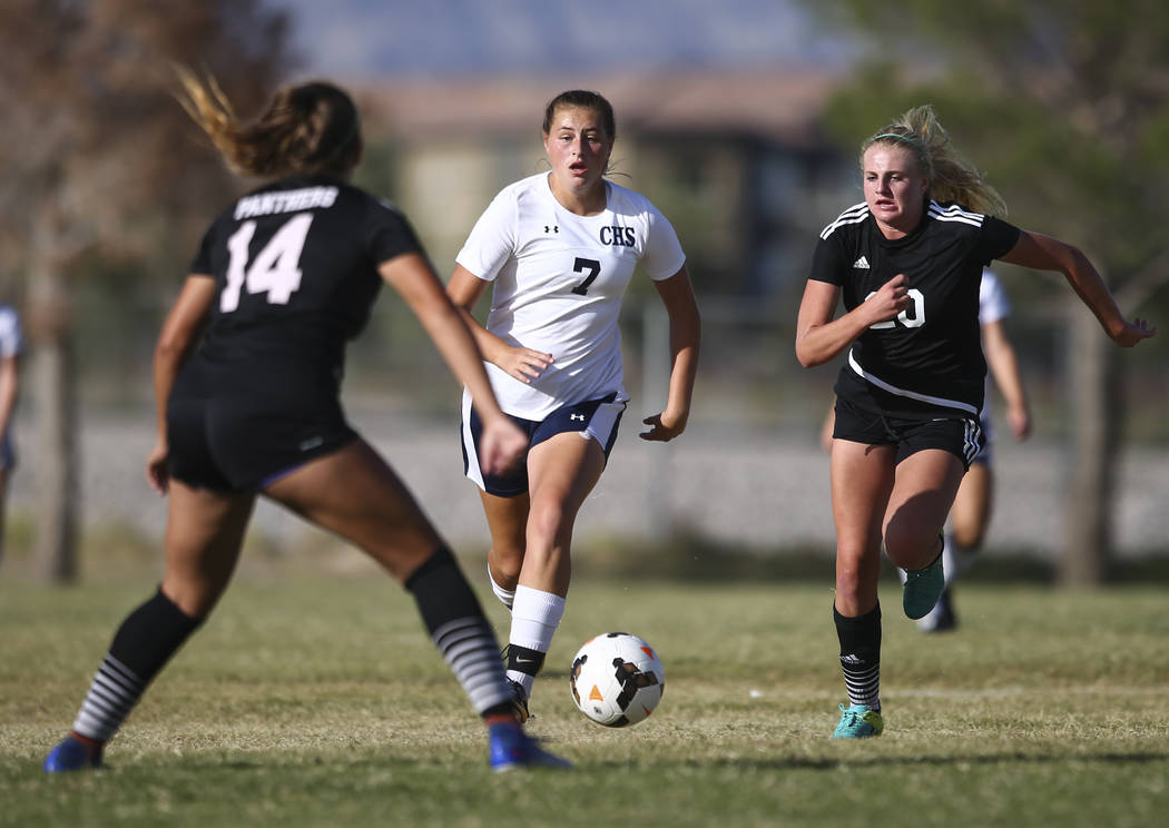Centennial's Marcella Brooks (7) keeps the ball ahead of Palo Verde's Carlee Giammona (20) during a soccer game at Centennial High School in Las Vegas on Tuesday, Sept. 19, 2017. Chase Stevens Las ...