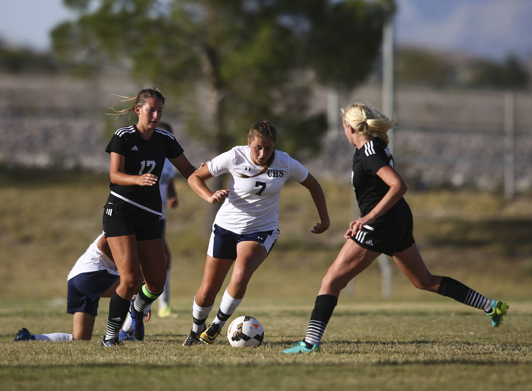 Centennial's Marcella Brooks (7) looks to get around Palo Verde's Carlee Giammona, right, during a soccer game at Centennial High School in Las Vegas on Tuesday, Sept. 19, 2017. Chase Stevens Las  ...