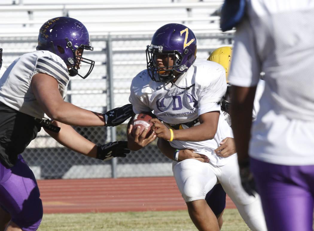 Durango High's running back T.K. Fotu, center, avoids a tackle during team's practice Wednesday Oct. 11, 2017, in Las Vegas. Bizuayehu Tesfaye Las Vegas Review-Journal @bizutesfaye