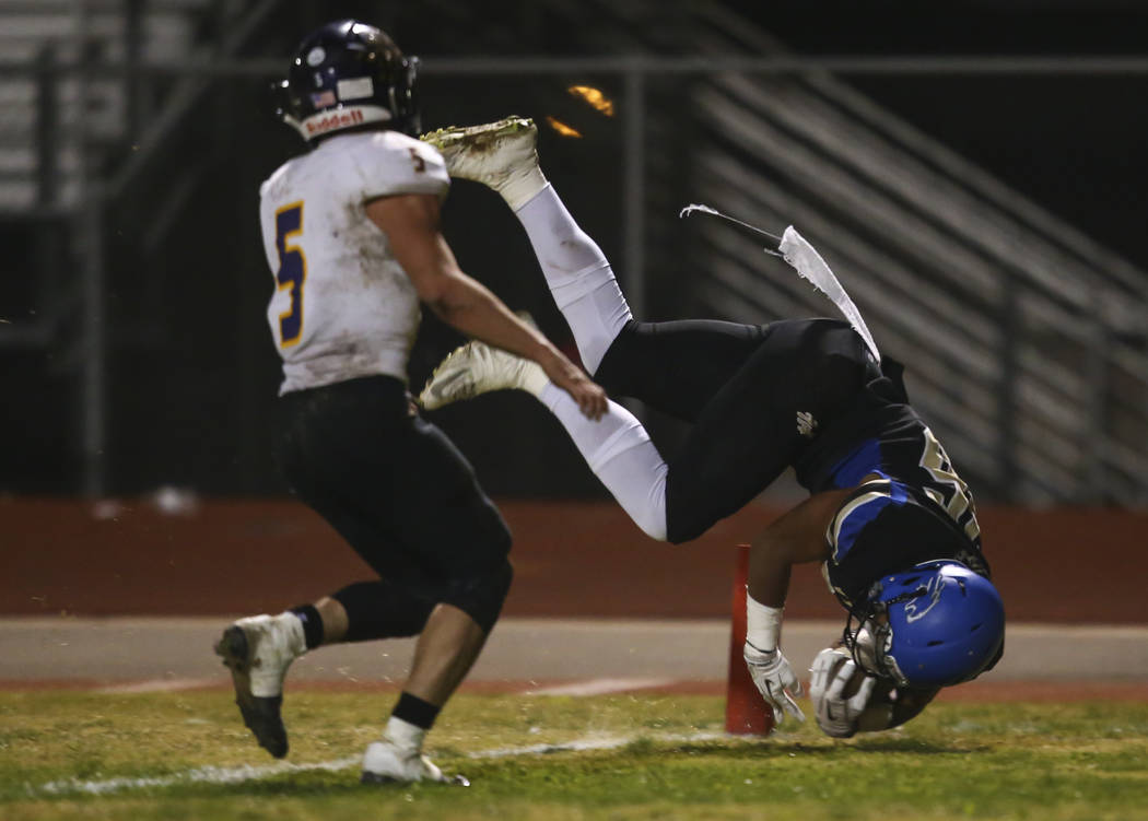 Sierra Vista's Kaika Faatiliga (36) scores a touchdown past Durango's Kaden Renshaw (5) during a football game at Sierra Vista High School in Las Vegas on Friday, Oct. 13, 2017. Chase Stevens Las  ...