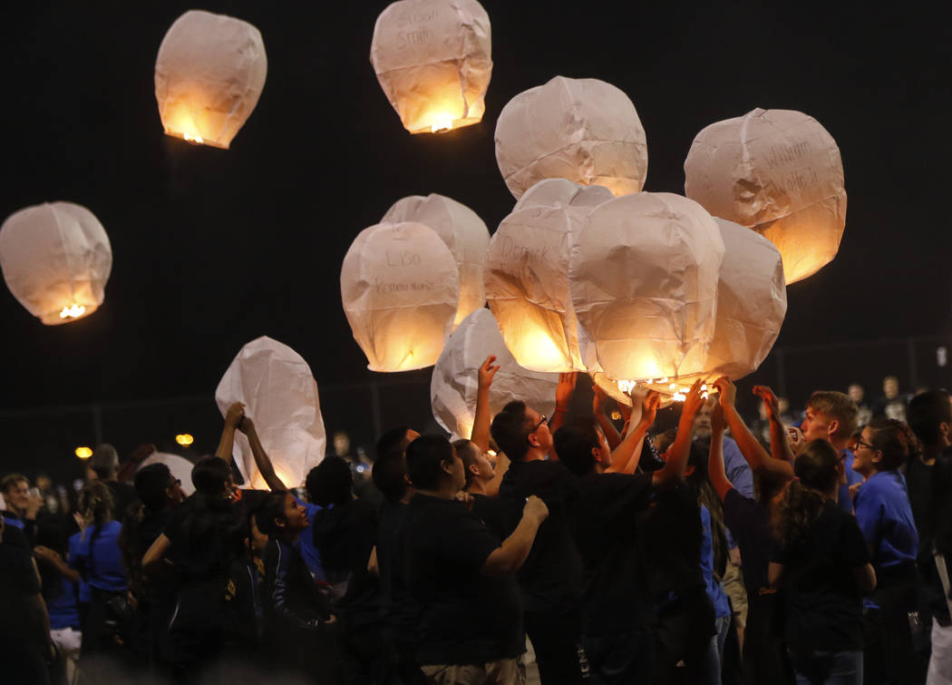 Students release balloons in honor of the victims of the Oct. 1 mass shooting before a football game at Sierra Vista High School in Las Vegas on Friday, Oct. 13, 2017. Chase Stevens Las Vegas Revi ...