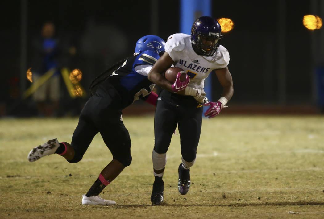 Sierra Vista's Kyler Corpuz (22) tackles Durango's T.K. Fotu (7) during a football game at Sierra Vista High School in Las Vegas on Friday, Oct. 13, 2017. Chase Stevens Las Vegas Review-Journal @c ...