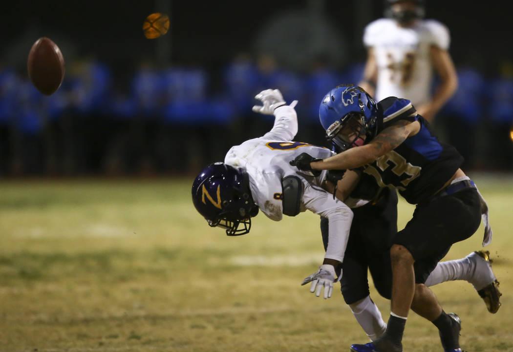 Sierra Vista's Jaxson Zibert (13) breaks up a pass intended for Durango's Johrdan Collins (8) during a football game at Sierra Vista High School in Las Vegas on Friday, Oct. 13, 2017. Chase Steven ...