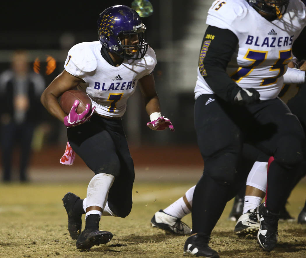 Durango's T.K. Fotu (7) runs the ball against Sierra Vista during a football game at Sierra Vista High School in Las Vegas on Friday, Oct. 13, 2017. Chase Stevens Las Vegas Review-Journal @cssteve ...