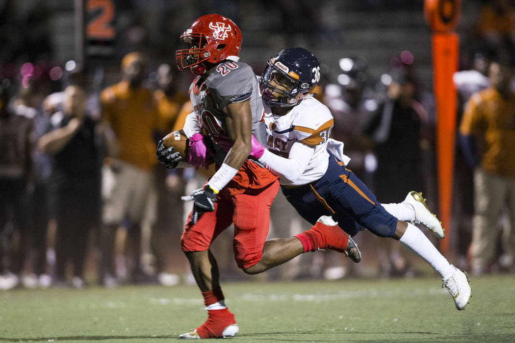 Arbor View's Jaquari Hannie (20) runs the ball against  Legacy's Amorey Foster (36) in the football game at Arbor View High School in Las Vegas, Friday, Oct. 13, 2017. Erik Verduzco Las Vegas Revi ...