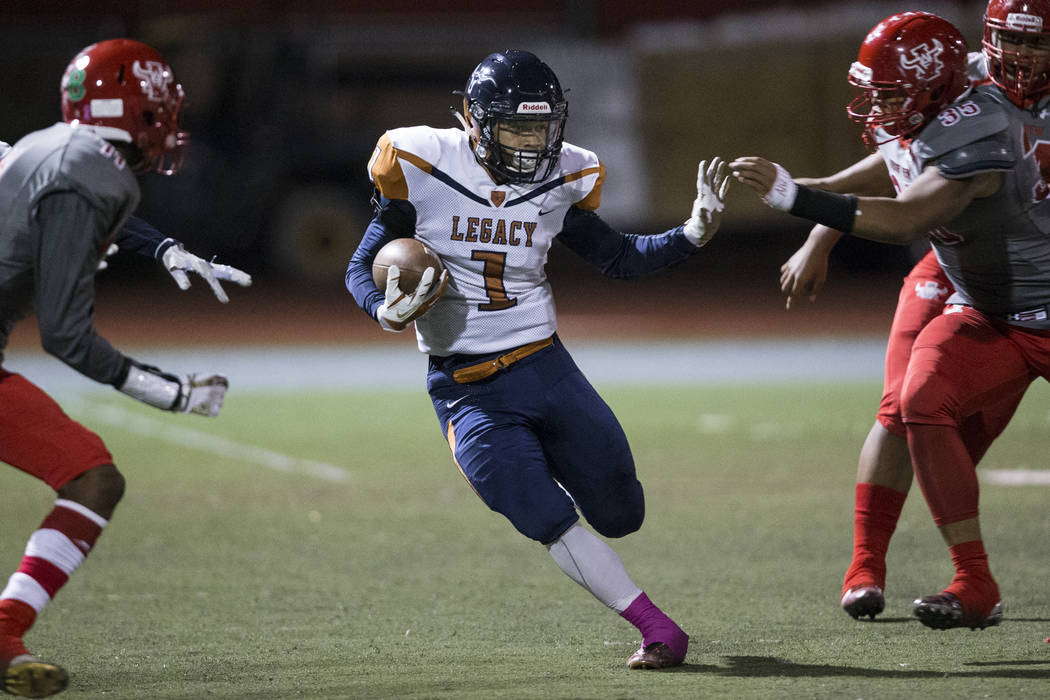 Legacy's Aubrey Washington (1) runs the ball against Arbor View in the football game at Arbor View High School in Las Vegas, Friday, Oct. 13, 2017. Erik Verduzco Las Vegas Review-Journal @Erik_Ver ...