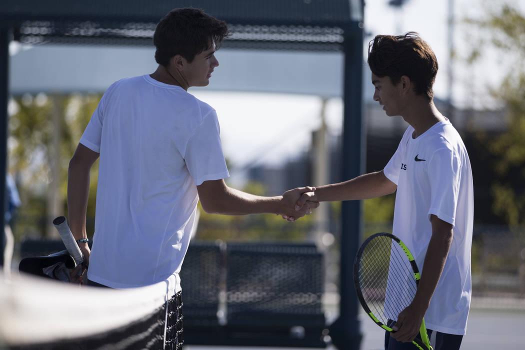Coronado's Sebastian Frace, left, and Zachary Sullivan shake hands after Frace's win in the boy's singles Sunrise Regional championship at the Darling Tennis Center in Las Vegas, Saturday, Oct. 14 ...