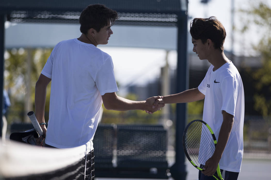 Coronado's Sebastian Frace, left, and Zachary Sullivan shake hands after Frace's win in the boy's singles Sunrise Regional championship at the Darling Tennis Center in Las Vegas, Saturday, Oct. 14 ...