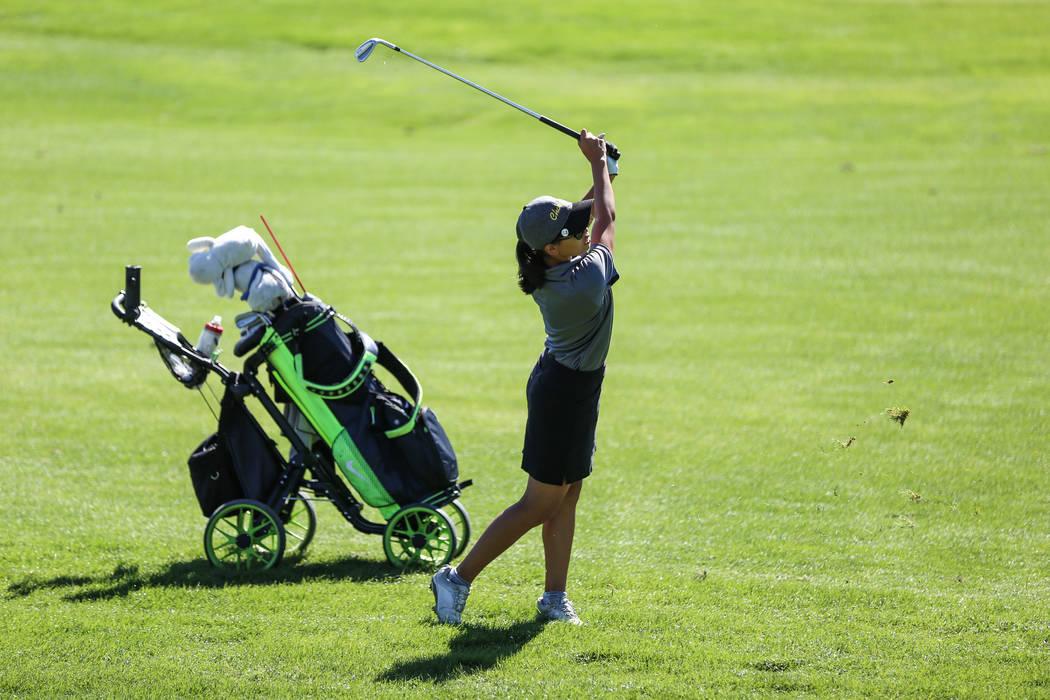 Clark's Riana Mission swings during the Class 4A Sunrise and Sunset Region girls golf tournaments at Bearճ Best Golf Club in Las Vegas, Tuesday, Oct. 10, 2017. Joel Angel Juarez Las Vegas Re ...