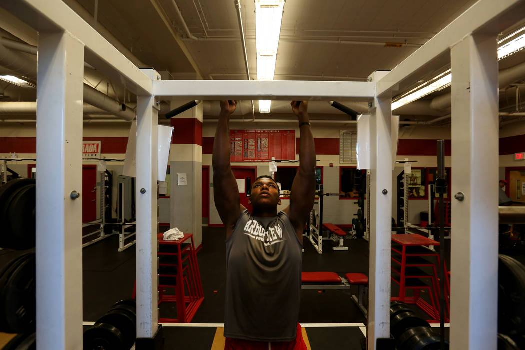 Arbor View's Elijah Wade, the best uncommitted football recruit in Nevada, completes pull-ups at Arbor View high school in Las Vegas, Monday, Oct. 16, 2017. Elizabeth Brumley Las Vegas Review-Jour ...