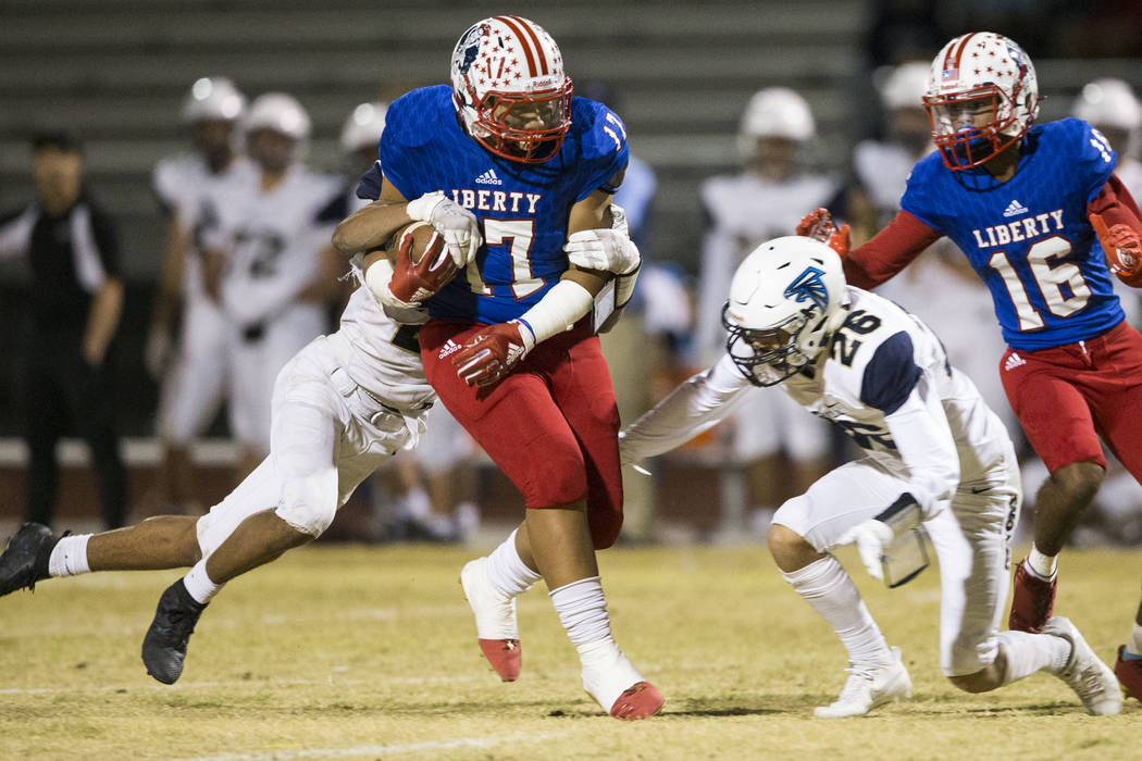 Liberty's Mana Moniz (17) runs the ball against Foothill in their football game at Liberty High School in Henderson, Friday, Oct. 6, 2017. Erik Verduzco Las Vegas Review-Journal @Erik_Verduzco