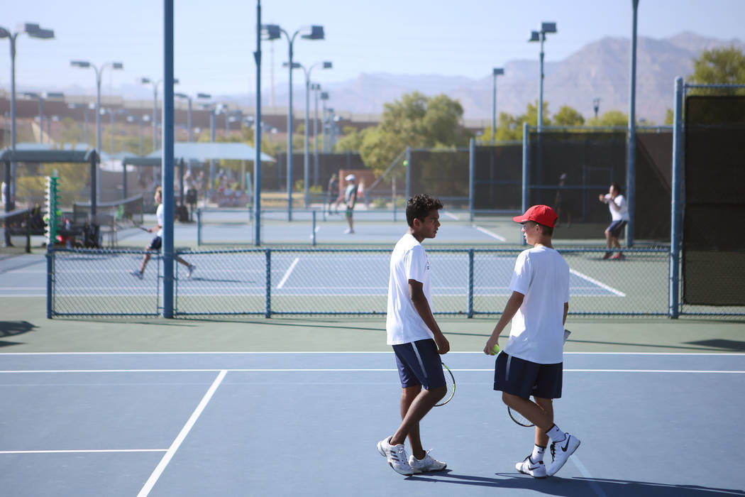 Coronado doubles players Ahkil Mohan, left, and Jack Hambrook talks during a boys state tennis semifinals match against Palo Verde at Darling Tennis Center in Las Vegas, Thursday, Oct. 19, 2017. B ...
