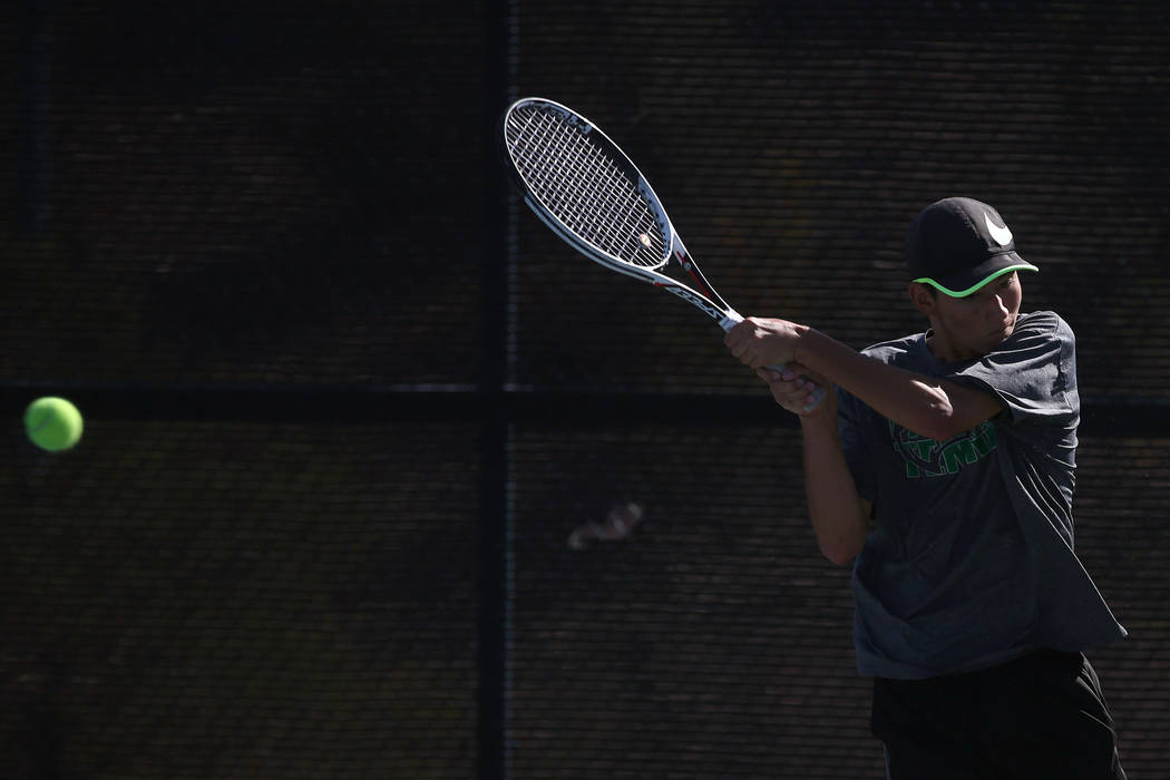 Palo Verde singles player Axel Botticelli hits the ball during boys state tennis semifinals match against Coronado at Darling Tennis Center in Las Vegas, Thursday, Oct. 19, 2017. Bridget Bennett  ...