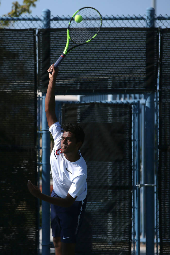 Coronado doubles player Ahkil Mohan serves the ball during a boys state tennis semifinals match against Palo Verde at Darling Tennis Center in Las Vegas, Thursday, Oct. 19, 2017. Bridget Bennett L ...