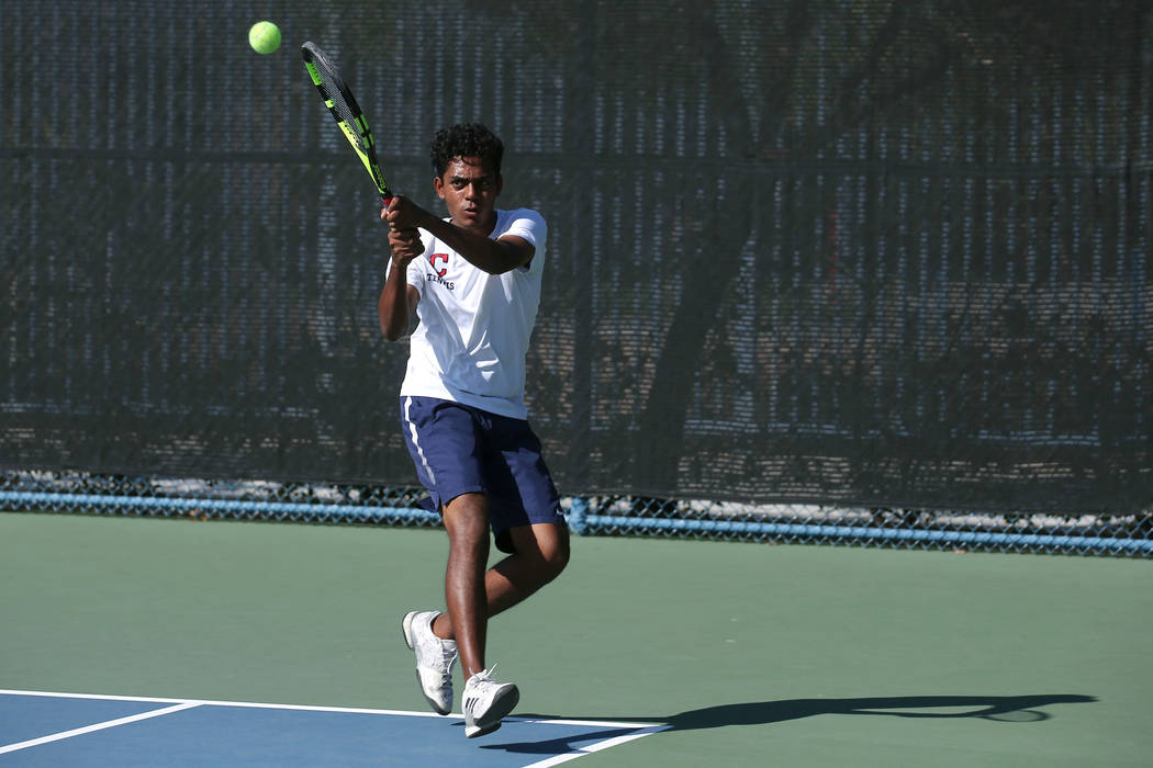 Coronado doubles player Ahkil Mohan hits the ball during a boys state tennis semifinals match against Palo Verde at Darling Tennis Center in Las Vegas, Thursday, Oct. 19, 2017. Bridget Bennett Las ...