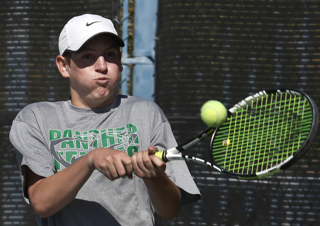 Palo Verde doubles player Travis Clingman returns the ball against Clark High during the Class 4A state finals at Darling Tennis Center Friday, Oct. 20, 2017, in Las Vegas. Bizuayehu Tesfaye Las V ...