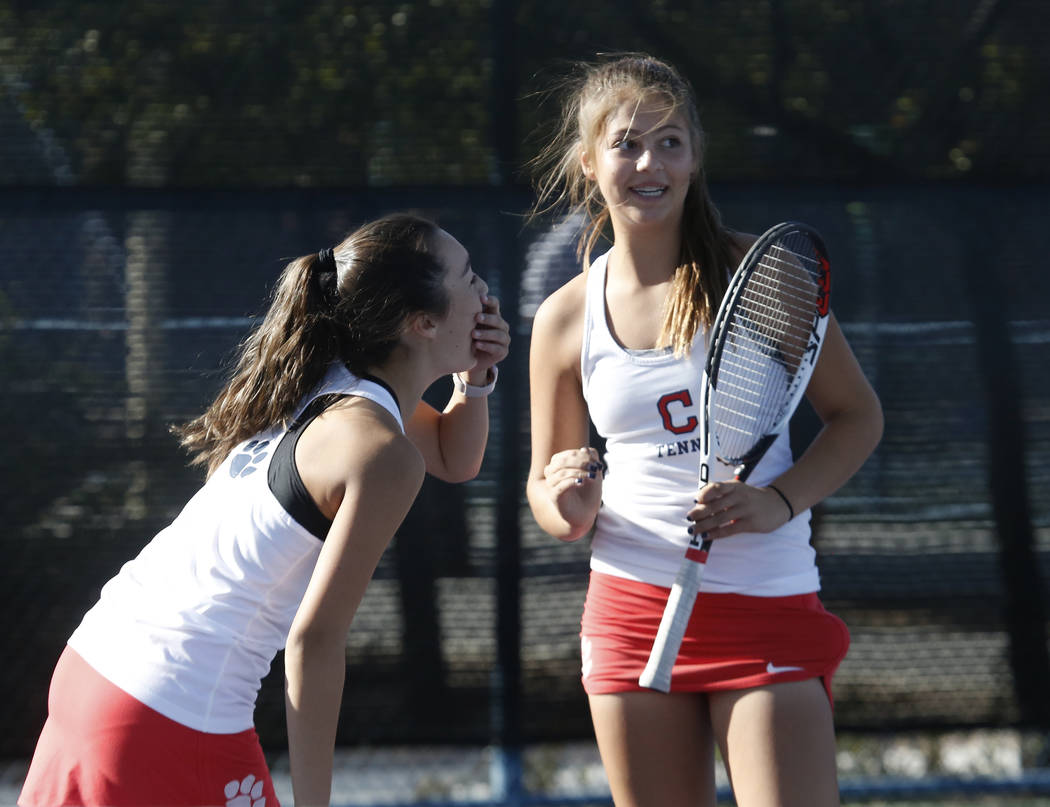 Coronado High's Sidra Wohlwend, left, and Ava Nhaisi celebrate their 6-3 win against Bishop Gorman during the Class 4A state doubles finals at Darling Tennis Center Friday, Oct. 20, 2017, in Las V ...