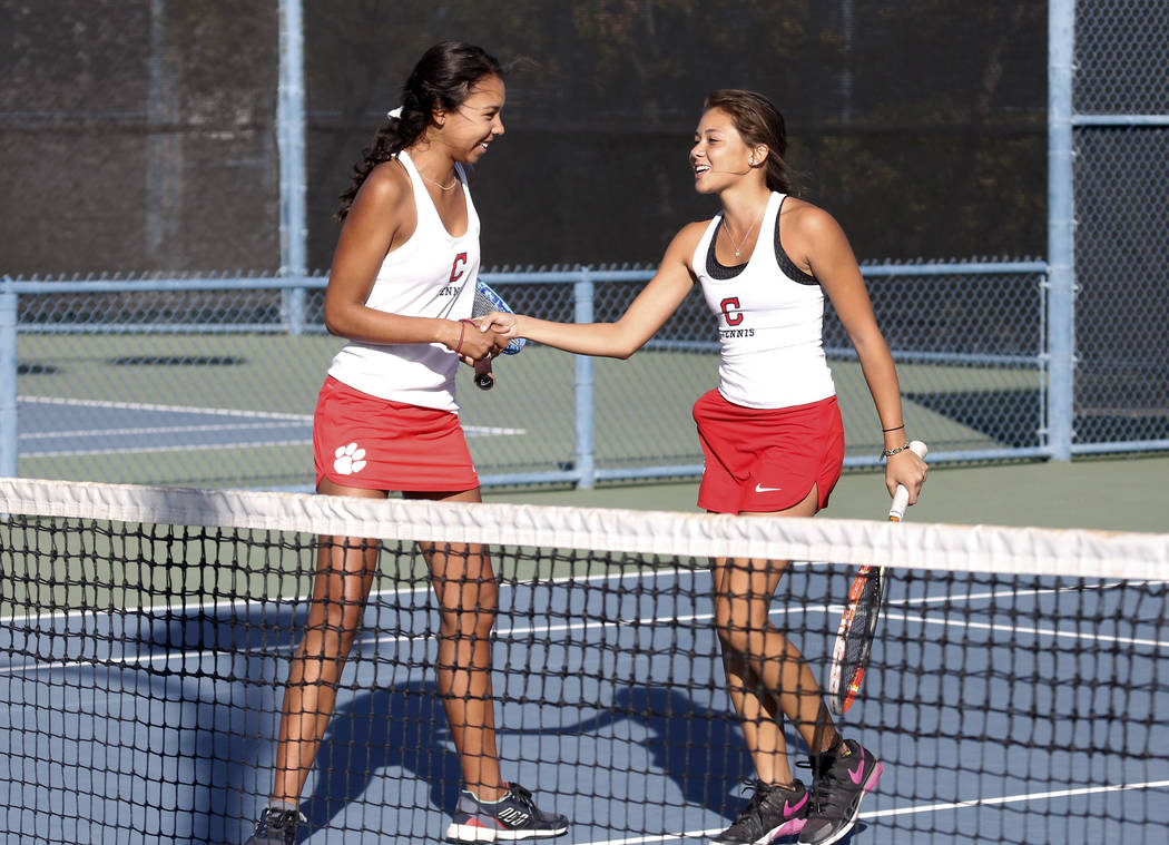Coronado High's Rayne Hayes, left, and Sophia Potamitis celebrate their 6-4 win against Bishop Gorman during the Class 4A state doubles finals at Darling Tennis Center Friday, Oct. 20, 2017, in La ...
