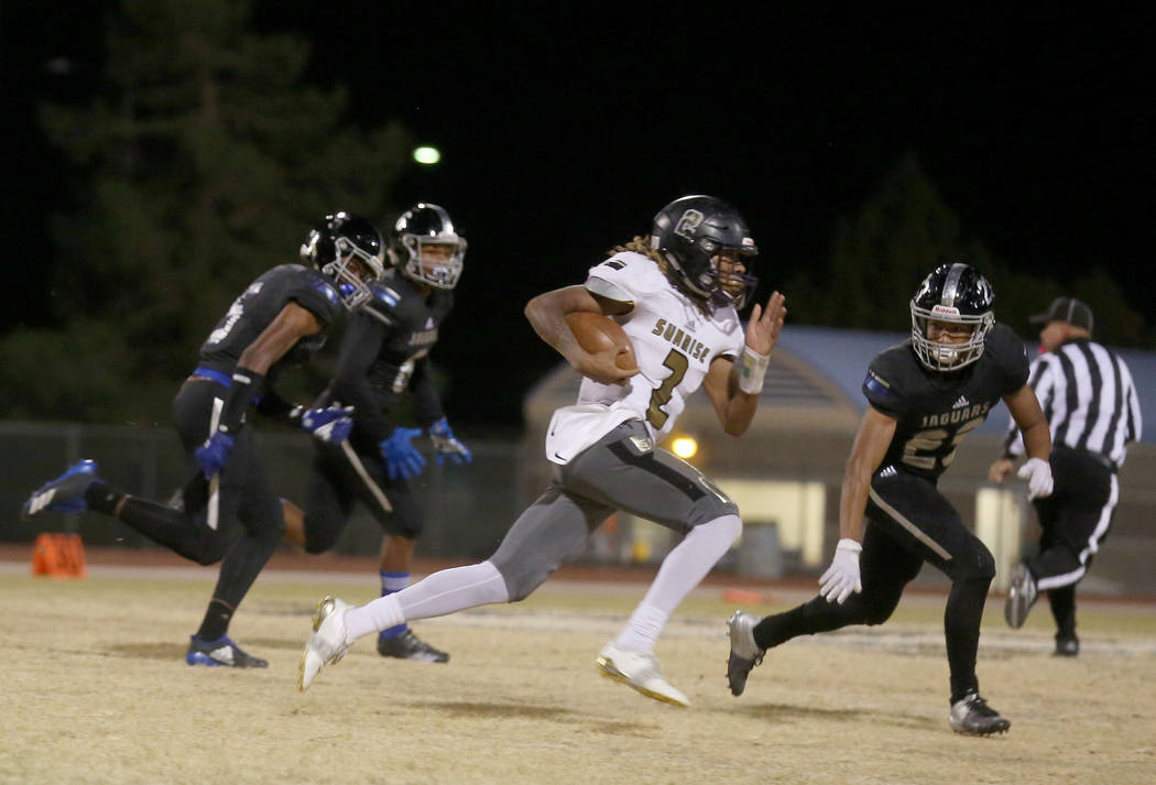 Sunrise Mountain's Pierce Williams, 2, runs with the ball against Desert Pines at Desert Pines High School in Las Vegas, Friday, Oct. 20, 2017. Elizabeth Brumley Las Vegas Review-Journal @EliPagePhoto