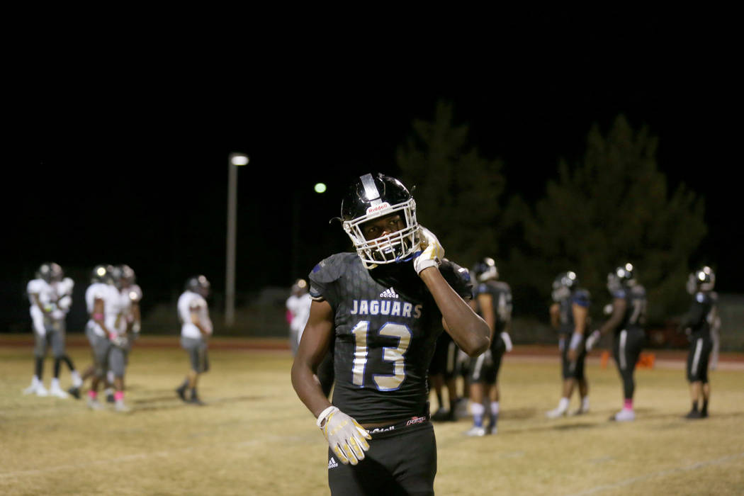 Desert Pines' Darnell Washington, 13,  takes off his helmet during a game against Sunrise Mountain at Desert Pines High School in Las Vegas, Friday, Oct. 20, 2017. Elizabeth Brumley Las Vegas Revi ...