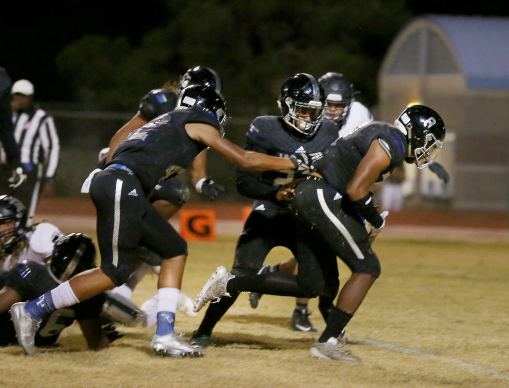 Desert Pines' linebacker Dejon Pratt, 8, runs with the ball after Sunrise Mountain's fumble at Desert Pines High School in Las Vegas, Friday, Oct. 20, 2017. Elizabeth Brumley Las Vegas Review-Jour ...