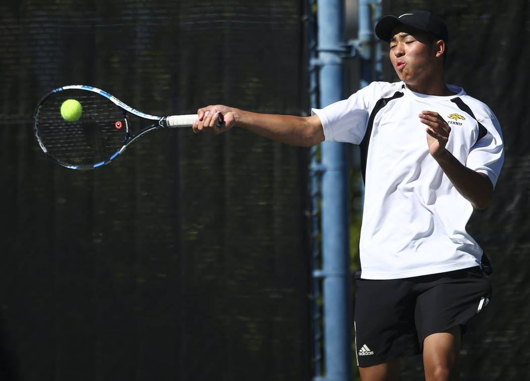 Clarkճ Michael Pasimio and Simran Shah, not pictured, compete against Desert Oasis in the Class 4A state final for boys doubles at Darling Tennis Center in Las Vegas on Saturday, Oct. 21, 20 ...
