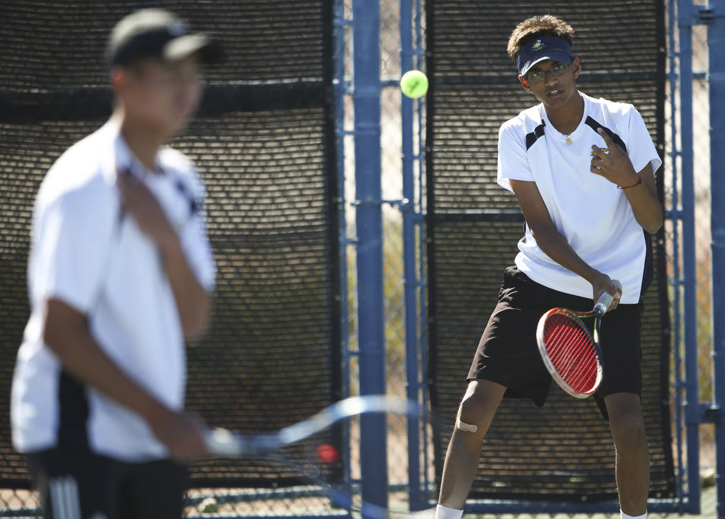 Clarkճ Simran Shah, right, and Michael Pasimio compete against Desert Oasis in the Class 4A state final for boys doubles at Darling Tennis Center in Las Vegas on Saturday, Oct. 21, 2017. Cla ...