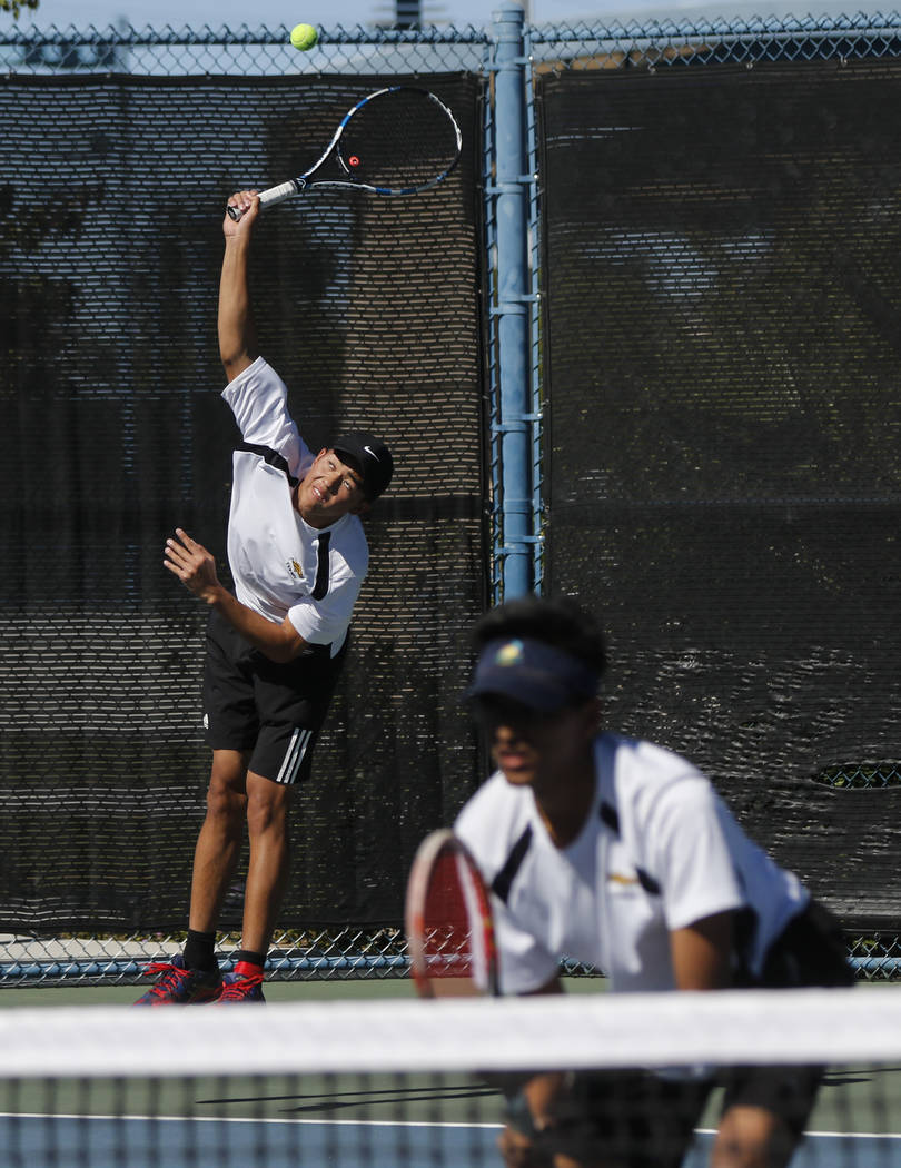 Clarkճ Michael Pasimio, left, and Simran Shah competes against Desert Oasis in the Class 4A state final for boys doubles at Darling Tennis Center in Las Vegas on Saturday, Oct. 21, 2017. Cla ...