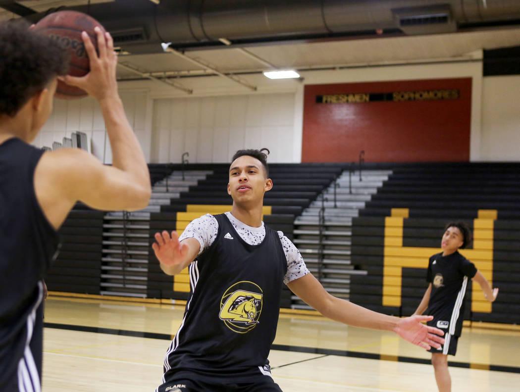 Clark High School senior Greg Foster guards during basketball practice at Clark High School in Las Vegas, Monday Oct. 23, 2017. Elizabeth Brumley Las Vegas Review-Journal @EliPagePhoto
