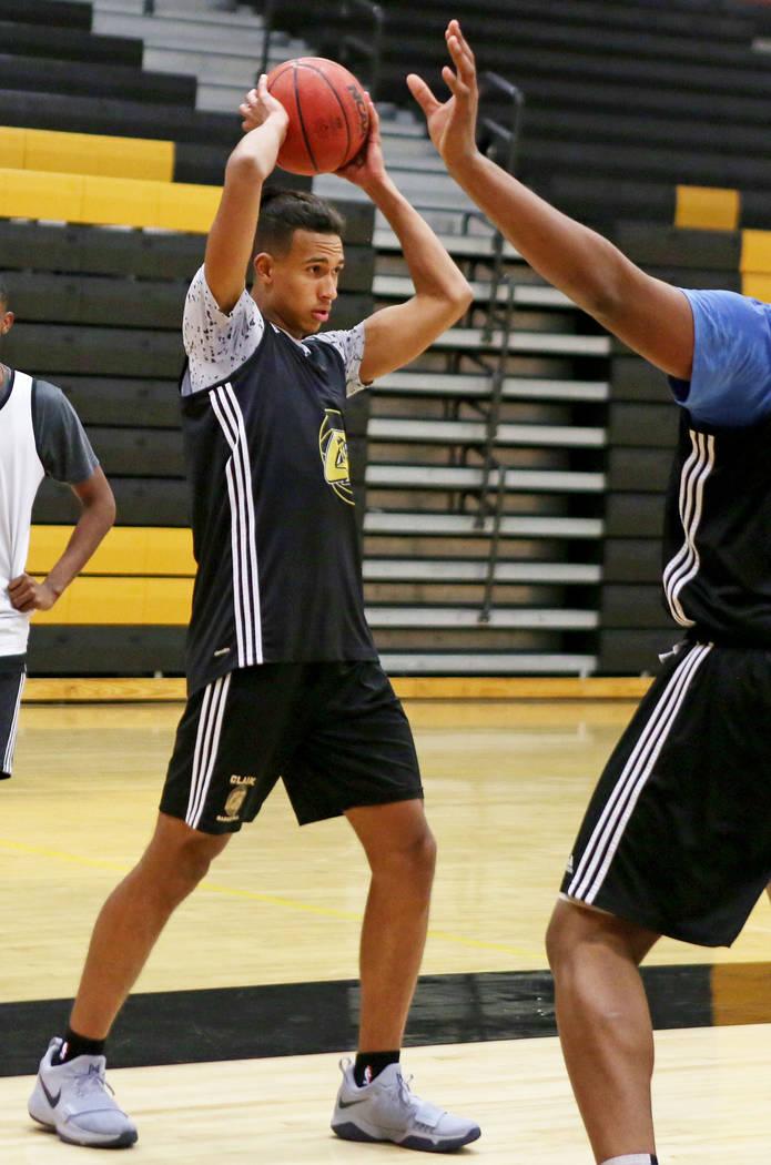 Clark High School senior Greg Foster passes the ball during basketball practice at Clark High School in Las Vegas, Monday Oct. 23, 2017. Elizabeth Brumley Las Vegas Review-Journal @EliPagePhoto