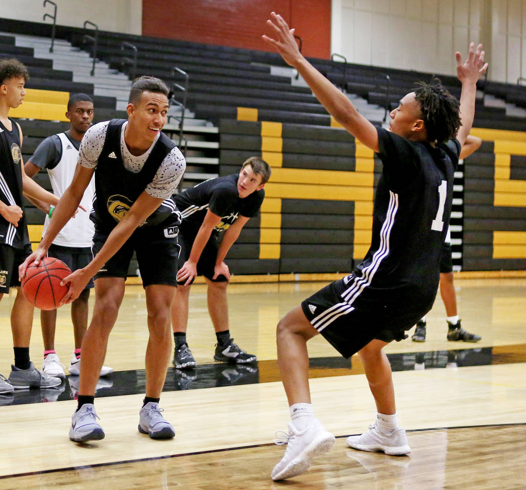 Clark High School senior Greg Foster prepares to pass the ball while Frank Collins guards during basketball practice at Clark High School in Las Vegas, Monday Oct. 23, 2017. Elizabeth Brumley Las  ...